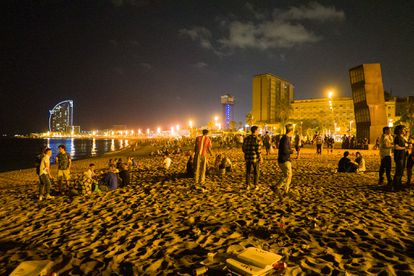 Youngsters on one of Barcelona's beaches on July 16. The coronavirus is spreading fast among young people in Spain right now.