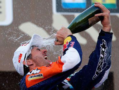 Marc Coma celebrates on the podium after winning a fourth Dakar Rally.