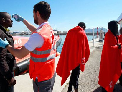 A Red Cross nurse attends to an immigrant in Algeciras.