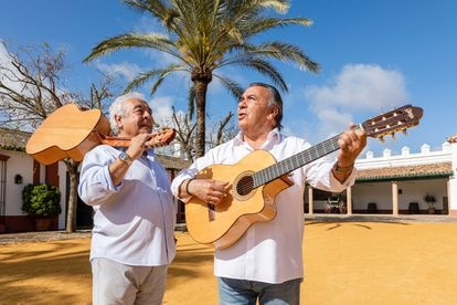 Los del Río playing the guitar at the villa in Utrera where they are acting as hosts.