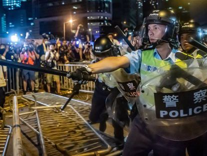 Riot police and protestors during a demonstration last week in Hong Kong.