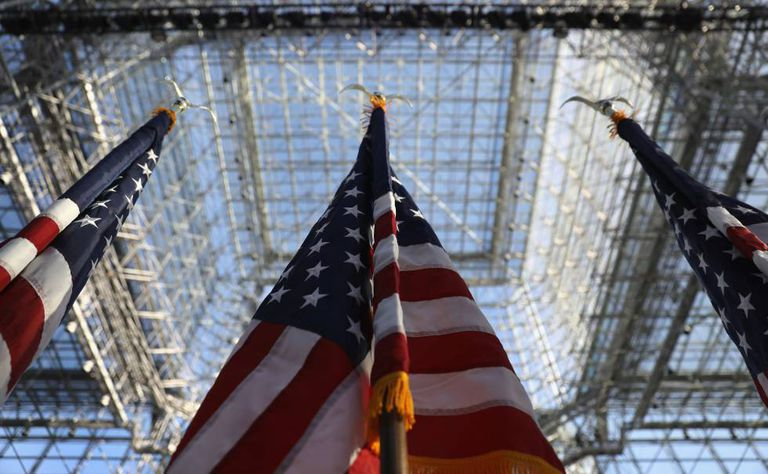 US flags under the Jacob Javits Center in New York City.