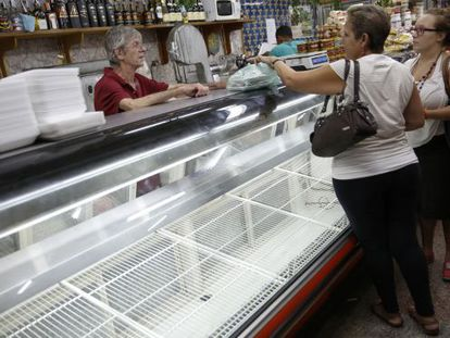 Venezuelan shoppers in an empty supermarket in Caracas.