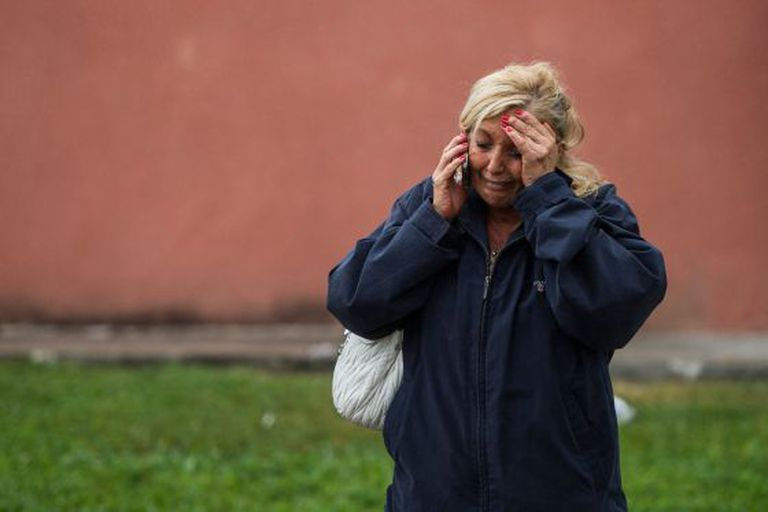 A relative of passengers involved in the Galicia train crash waits for news on Wednesday morning.