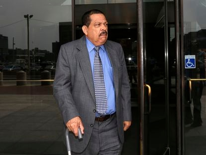 In this Aug. 22, 2013 file photo, former El Salvadoran military colonel Inocente Orlando Montano walks out of federal court in Boston.