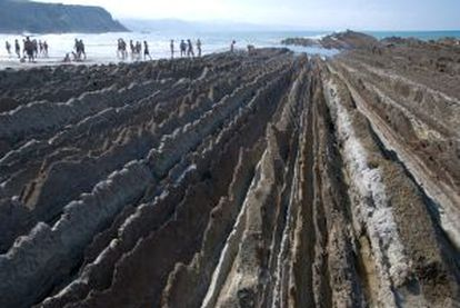 "Swimmers near the ""Flysch"" of Zumaia"