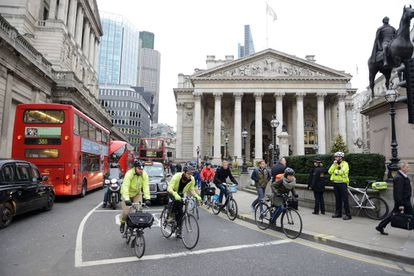 Cyclists in London traffic.