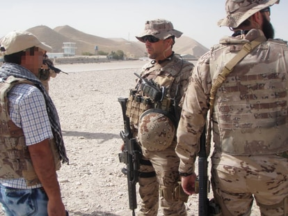'Amal' (l), an interpreter, working with Spanish armed forces in this file photo.