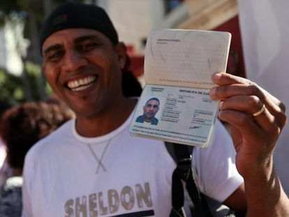 A man shows off his passport in Havana.