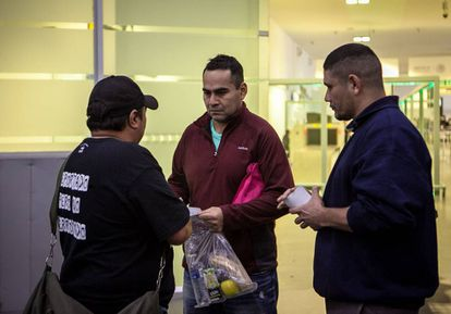 Felipe (right) and a friend meet a deported immigrant off the plane.