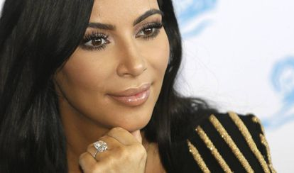 Kim Kardashian, with the engagement ring stolen from her in Paris.