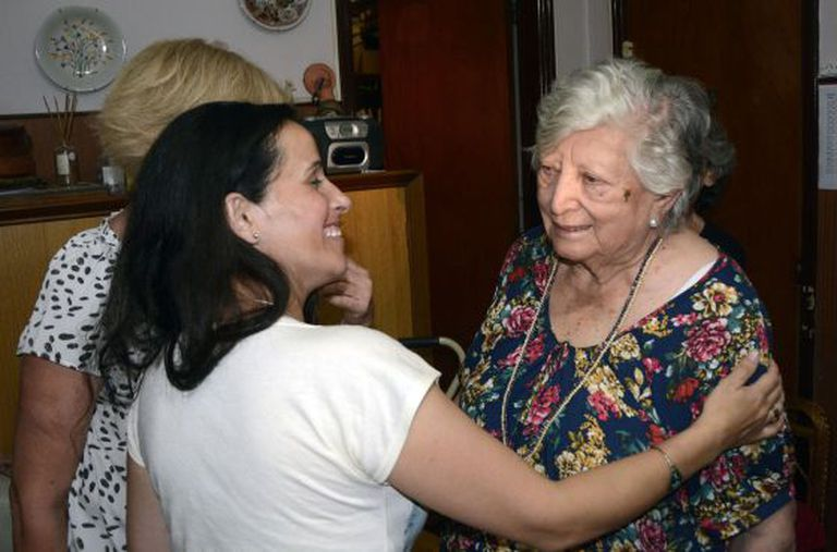 Chicha Mariani (r), a founder of the Grandmothers of Plaza de Mayo, greets a young woman on Thursday who claimed to be her missing granddaughter.