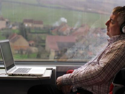 A passenger relaxes on Spain's high-speed AVE service.
