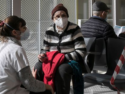 A woman waits to be vaccinated in Barcelona in February.