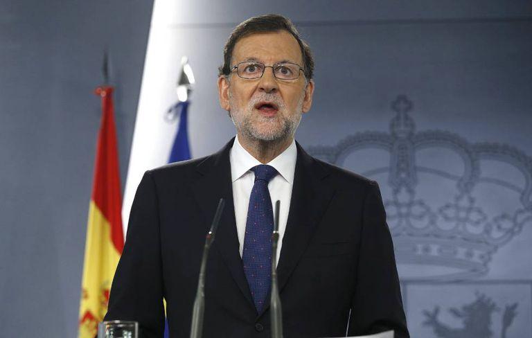 Acting PM Mariano Rajoy at a press conference on Friday.