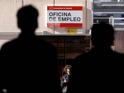 People outside an employment office in Madrid.