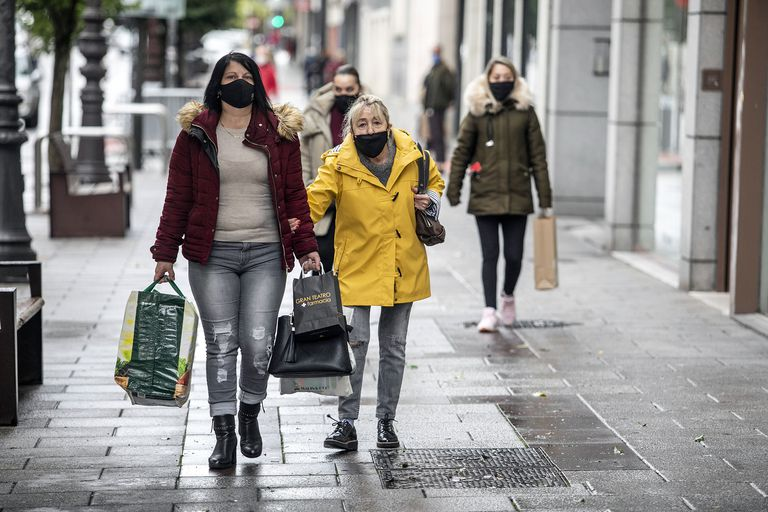People walk down a street in Burgos, which will be placed under a perimetral lockdown on Friday.