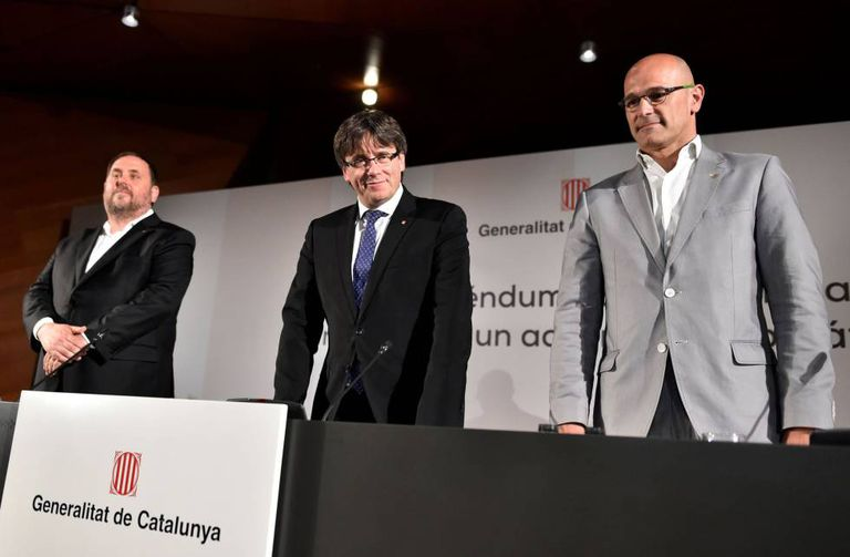 Oriol Junqueras, Carles Puigdemont and Raul Romeva in Madrid on Monday.