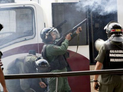Members of Venezuela's Bolivarian National Guard fire tear gas at protestors during nationwide demonstrations last year.