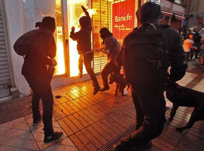 Hooded protestors set fire to a bank in Santiago during a Mapuche march on January 3.
