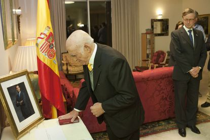 Marco Macías swears before a picture of Spain's King Felipe at the ceremony on Tuesday.