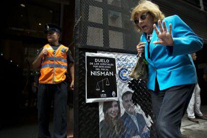 A woman passes the office of prosecutor Viviana Fein.