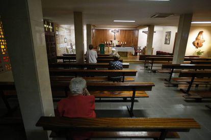 Worshipers pray at a chapel in Madrid.