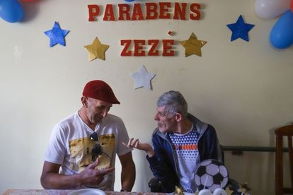 Bento Marcio da Silva, left, and Zezé during the latter's 60th birthday party at their residence in Barbácena.