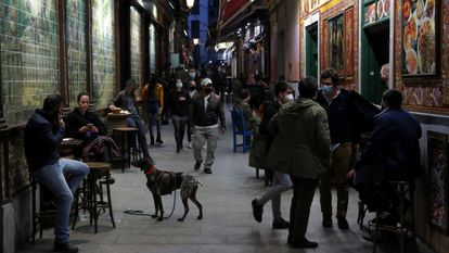 People walk through a street in the center of Madrid at the beginning of February.