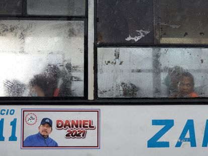 A poster in support of Nicaraguan President Daniel Ortega on a public bus in Managua.