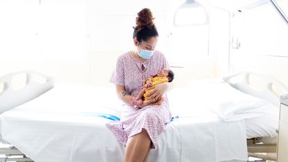 A woman with her newborn at Vall d'Hebron hospital in Barcelona.