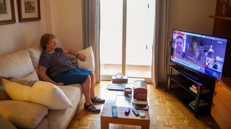 Pilar Orgaz watches television from her home in Madrid. She has only left once to go to a hairdresser.
