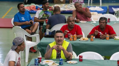 Evacuated locals take shelter in a sports center in Agaete.