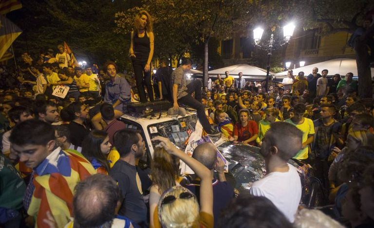 Demonstrators outside the regional economy department in Barcelona on Wednesday night.