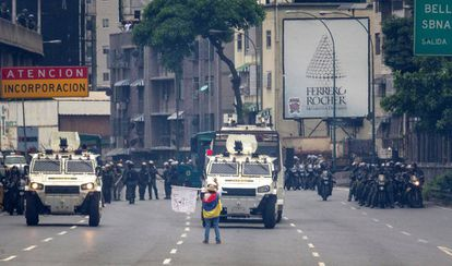 María José Castro brings an armored car to a halt by standing in front of the vehicle on May 3rd.