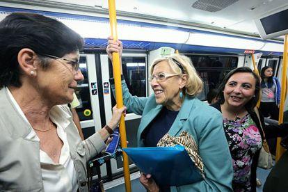 Madrid Mayor Manuela Carmena taking the metro to work.