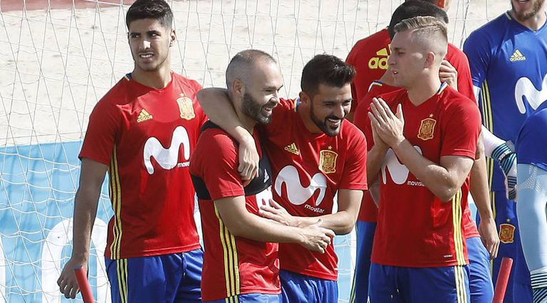 David Villa, Andres Iniesta, Asensio, and Reina.