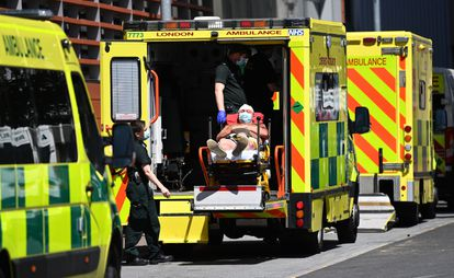 A Covid-19 patient is brought to a London hospital on June 14.