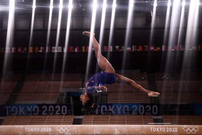 Simone Biles competes in the artistic gymnastics balance beam event of the women's qualification during the Tokyo 2020 Olympic Games.