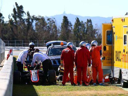 Fernando Alonso receives medical assistance after Sunday's crash.