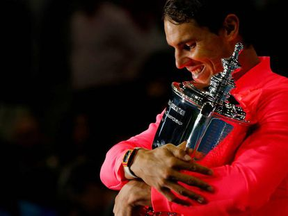 Nadal holds the US Open trophy in New York.