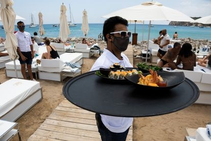 A worker at the Blue Marlin carrying a tray of food last Thursday.