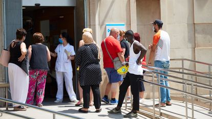 People waiting outside Prat de la Riba primary healthcare center in Lleida on Tuesday.