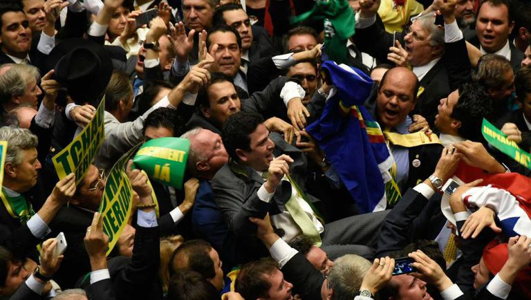Opponents celebrate Congress's decision to approve impeachment of Rousseff.