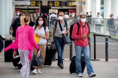 Travelers arriving at Palma airport last month.