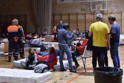 Residents take refuge from the flooding.