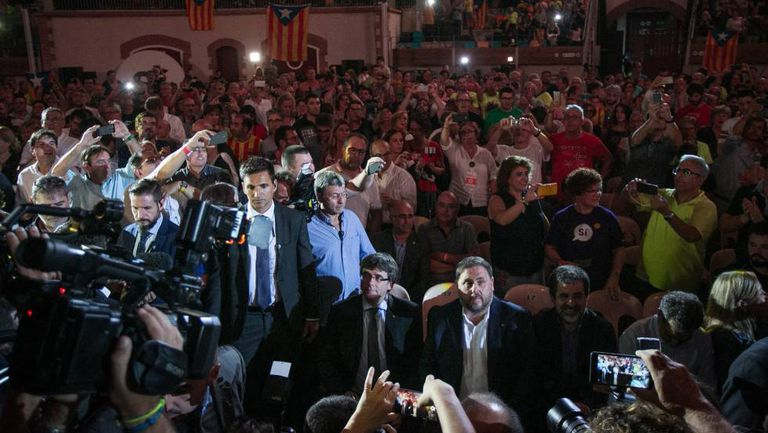 Carles Puigdemont, left, and Oriol Junqueras, center, at the campaign rally.