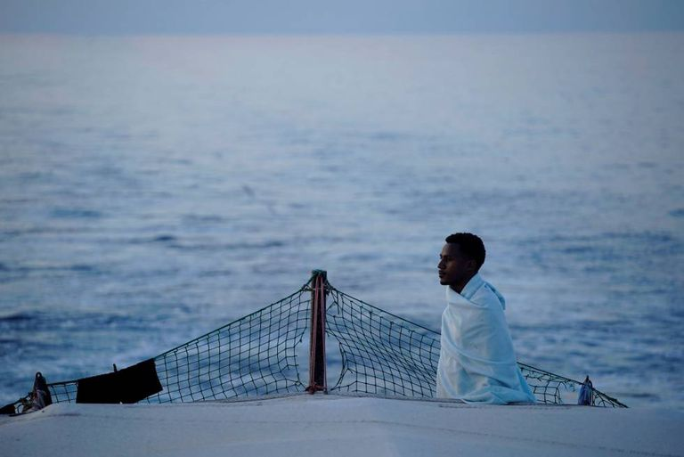 A migrant on board the 'Open Arms' rescue ship.