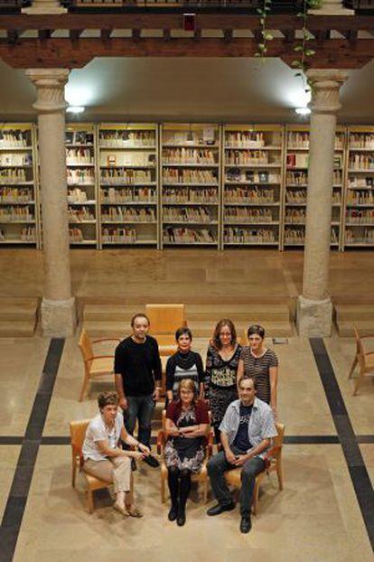 Library director Blanca Calvo (standing, second from left) with volunteers.