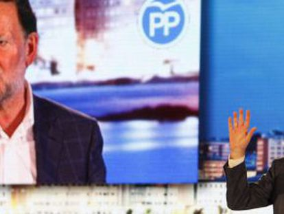 Prime Minister Mariano Rajoy addresses a rally in A Coruña with marks from the punch visible on his face.